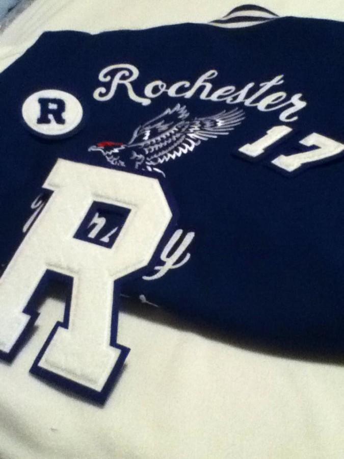 A+Varsity+jacket+with+the+block+%22R%22%2C+class+year+numbers%2C+and+JV+patch.+
