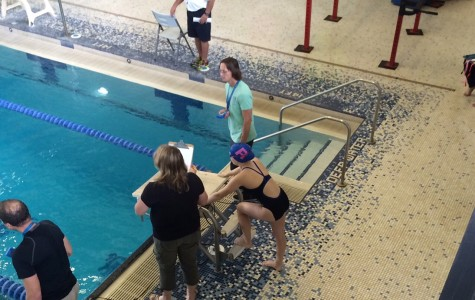 Women's Swim Team Juggles Homecoming and a Swim Meet on the Same Day