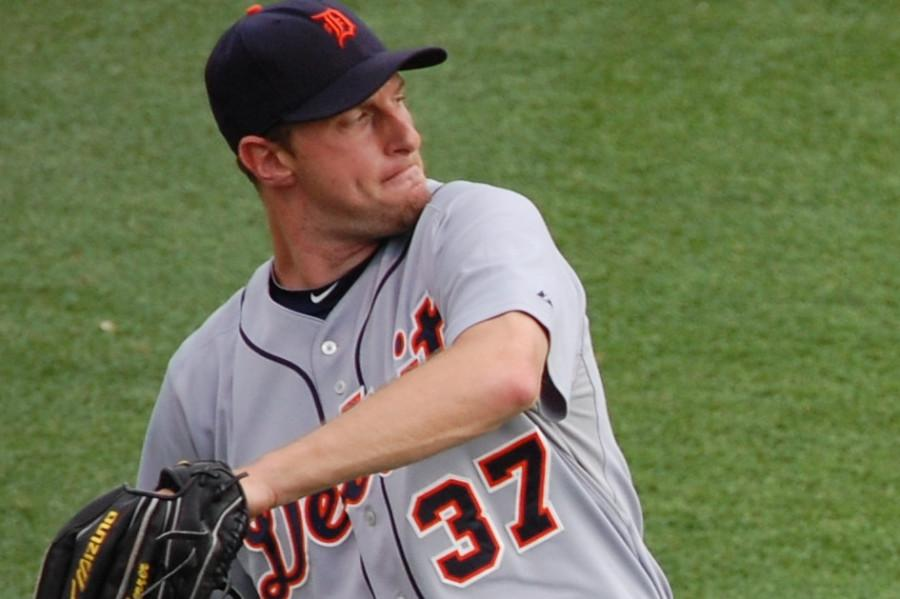 Ace Max Scherzer keeps playoff hopes alive, beat Athletics 8-6.
