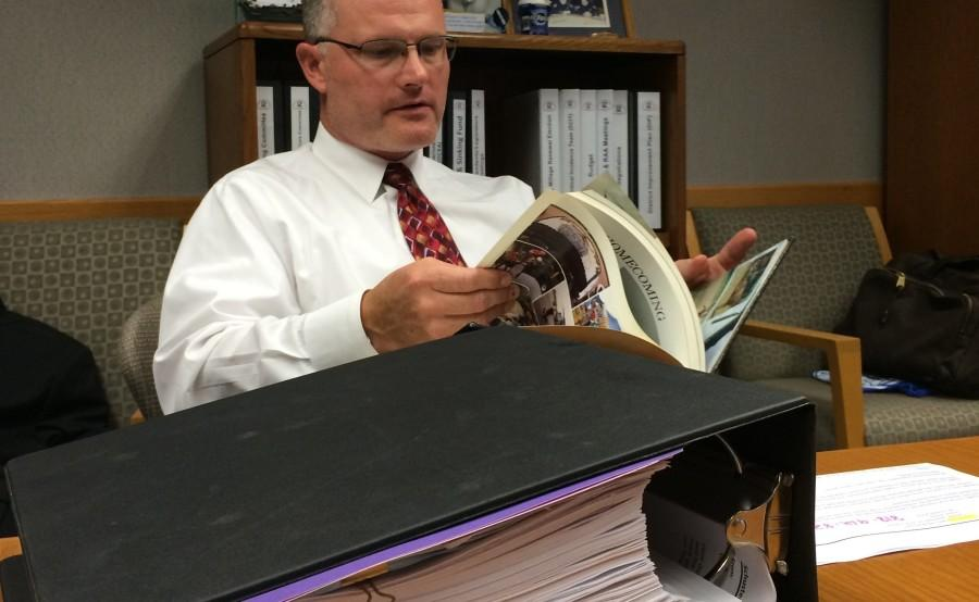 Dr. Shaner with binder full of emails