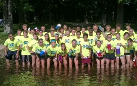 The XC team cools off in the Clinton river after a hard workout.