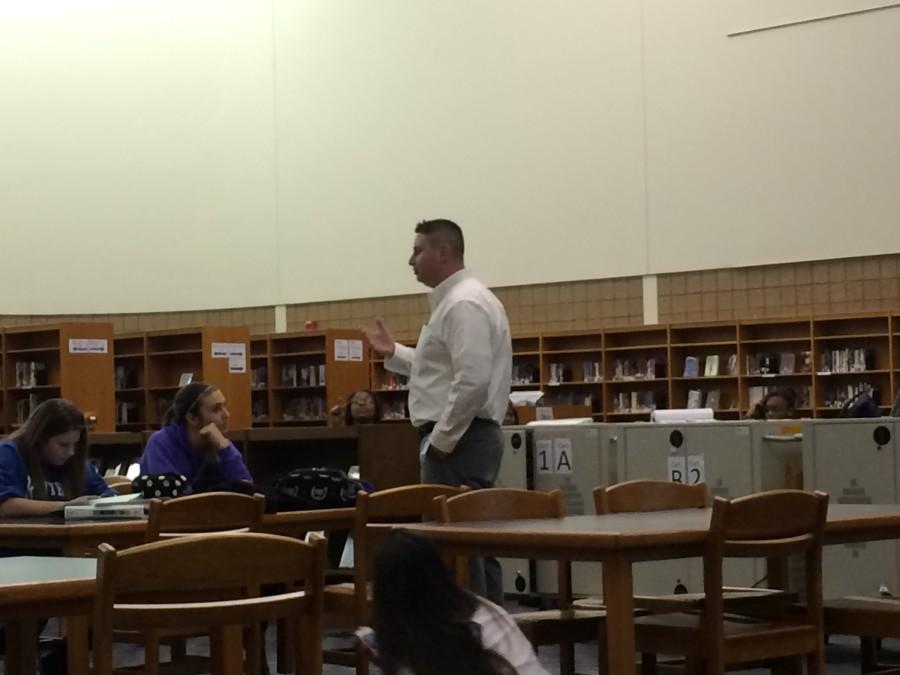 Mr. Luea speaks to the Falcon 9 club members.