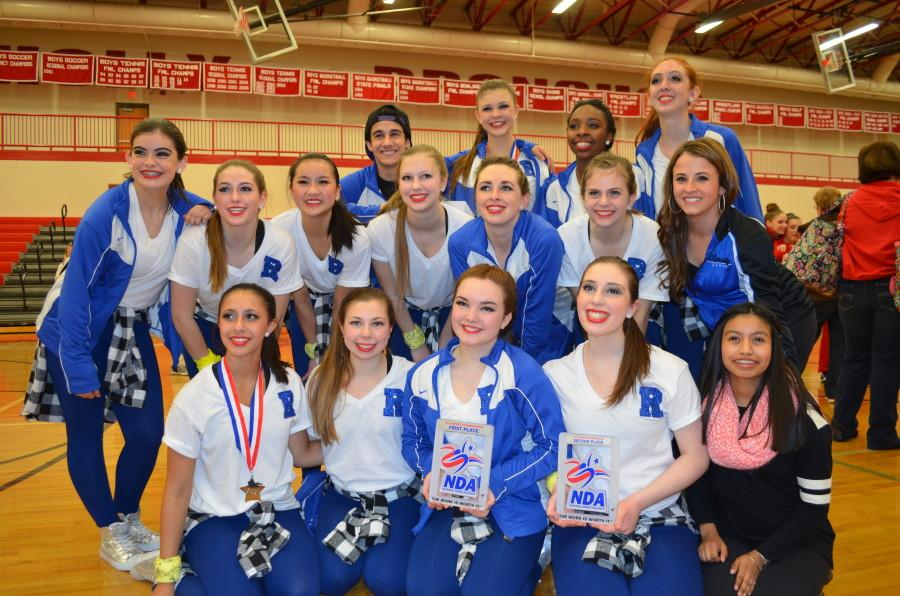 The RHS varsity dance team poses with their awards from the Oakland County Spirit Championships
