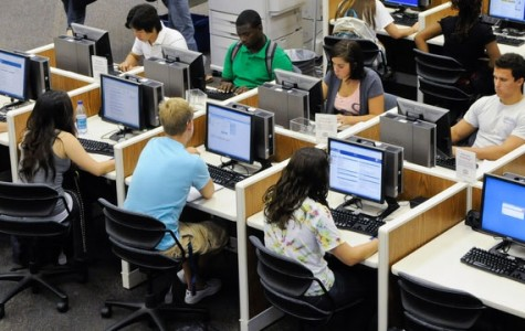 Students are taking computerized tests in a library.
