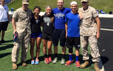 The top two female and male athletes pose with the marines after the bootcamp training session.
