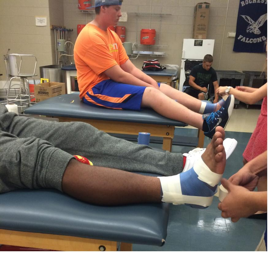 Junior Jameir Scott gets his ankle taped in RHS training room.
