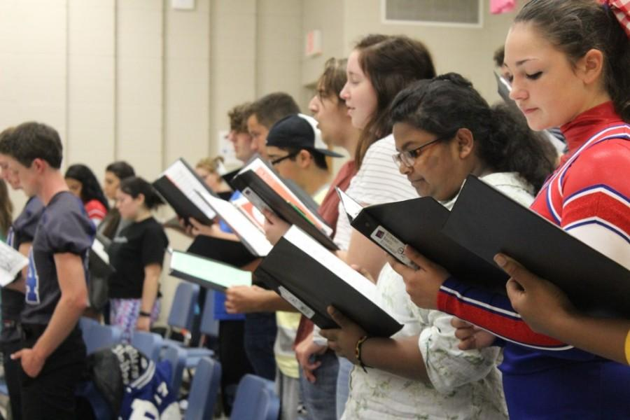 Choir students  Ashley Wright and Meghana Subramanyam work on their songs for the college concert.