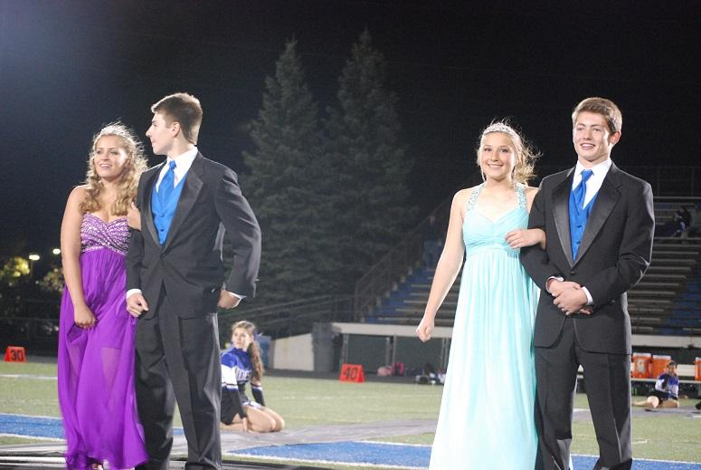 Freshmen Erika Bradlee, Ryan Hart, Julia Payne and Mat Petrusha smile for the cameras during their halftime appearance