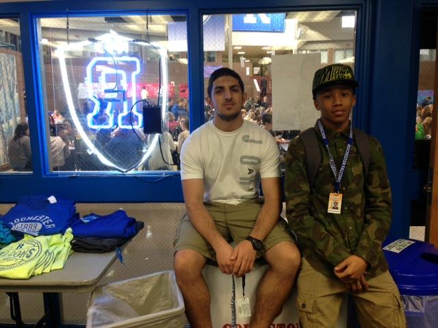 Senior Ramey Orow and junior Ahmed Anthony take a break from selling merchandise at the Falcon's Nest.