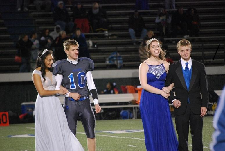The+juniors+endure+the+cold+as+the+homecoming+king+and+queen+are+announced.