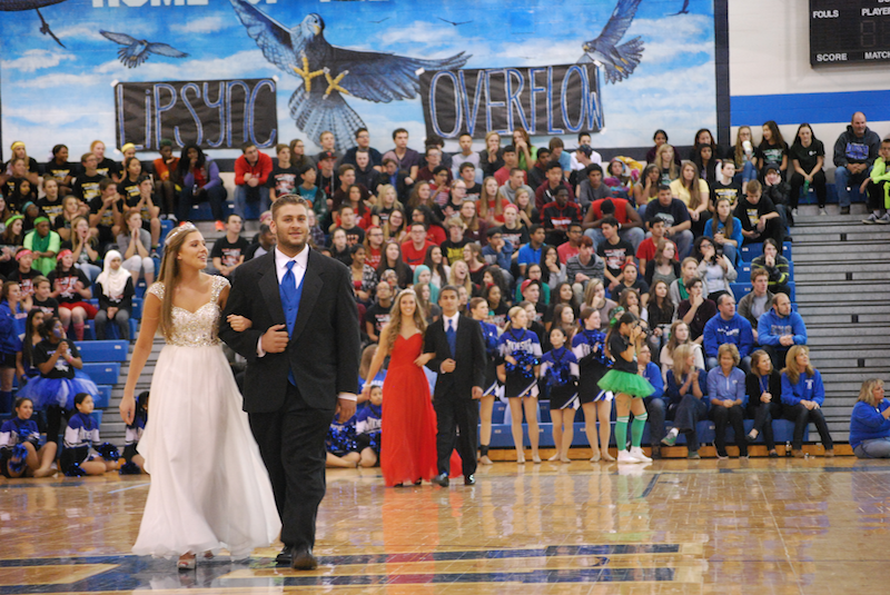 The+senior+homecoming+court+members+walked+through+the+gym+as+the+crowd+goes+wild+for+their+class+representatives.
