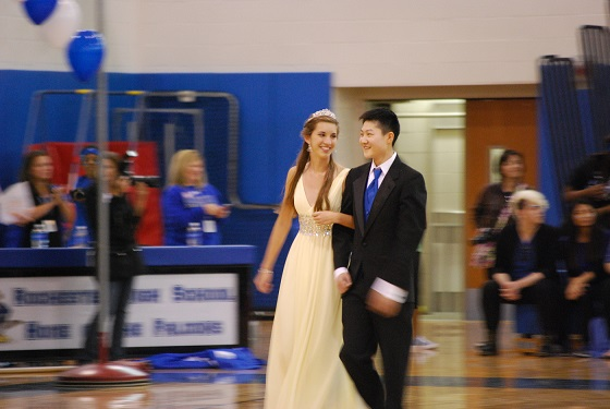 Sophomores Ellie Gnass and Dennis Kim walk down together at the pep assembly