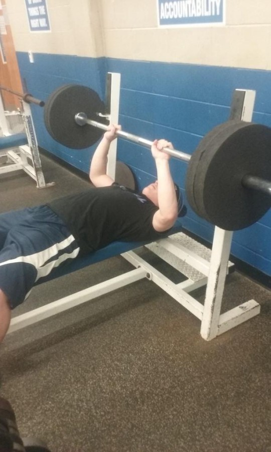 Sophomore varsity basketball player Hunter Schattler puts in work on the bench press.