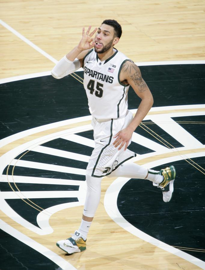 Michigan State's Denzel Valentine celebrates after hitting a three-point shot during the first half of an NCAA college basketball game against Indiana, Monday, Jan. 5, 2015, in East Lansing, Mich. Valentine led Michigan State with 15 points in a 70-50 win. (AP Photo/Al Goldis)