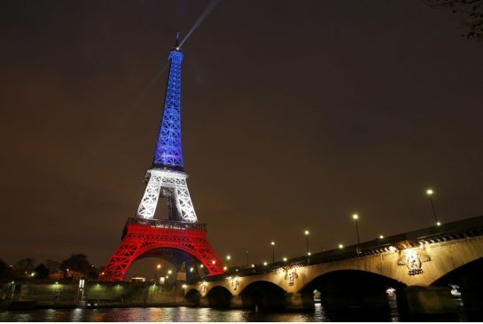 The Eiffel Tower shines bright with French colors after the devastating attacks of November 13th.  Photo courtesy of www.thestar.com