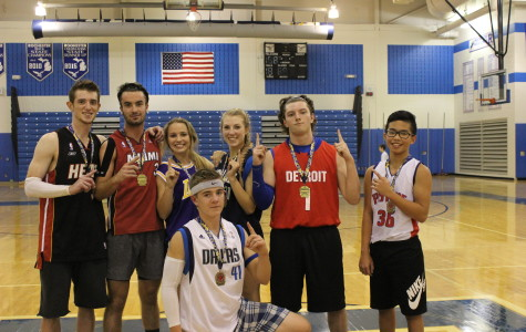 The winning team gets their first place medals.