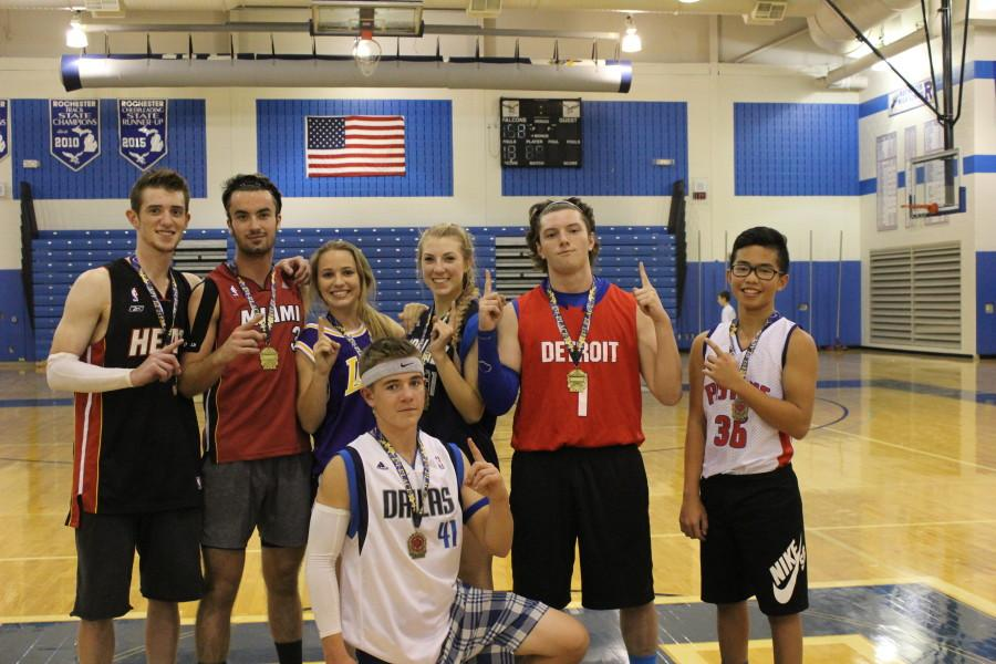 The+winning+team+gets+their+first+place+medals.