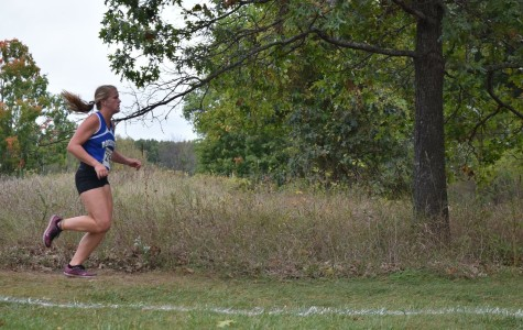 Audrey Weber runs in one of her cross country meets.
