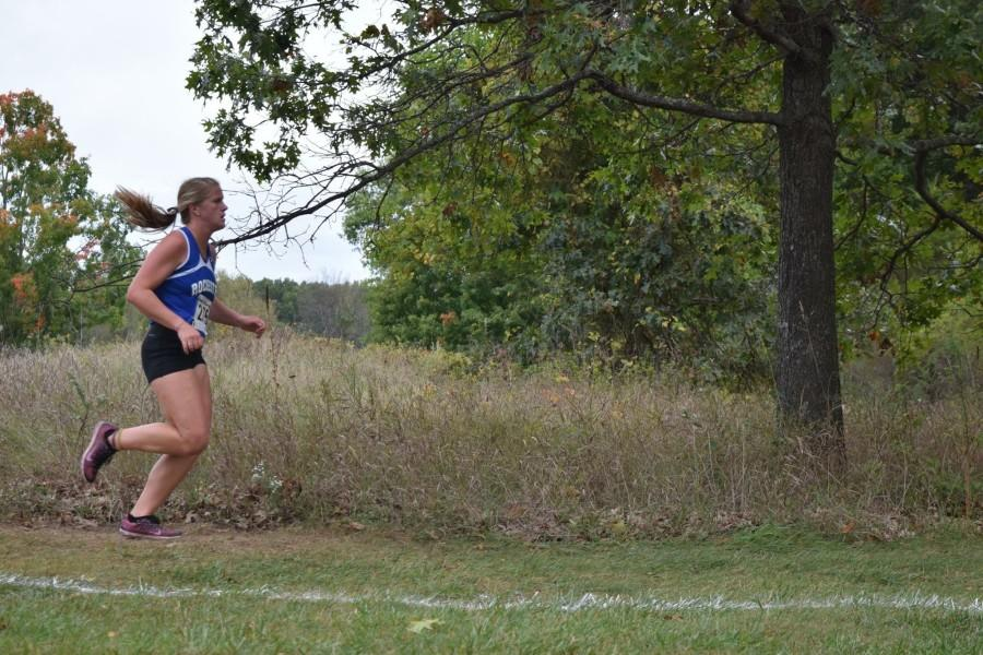 Audrey+Weber+runs+in+one+of+her+cross+country+meets.+