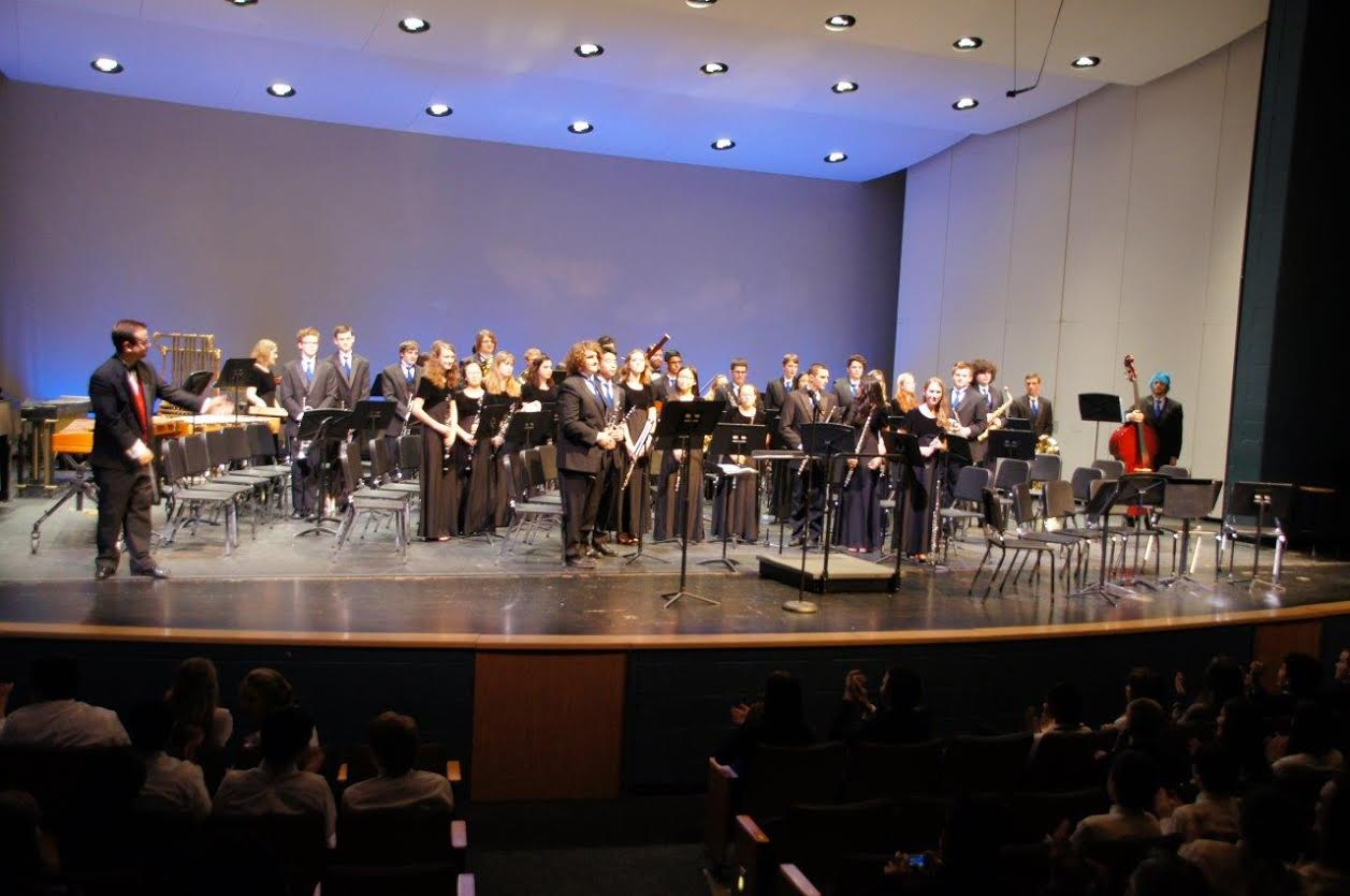 The wind ensemble, which Benson is a part of, stand proudly after a performance.