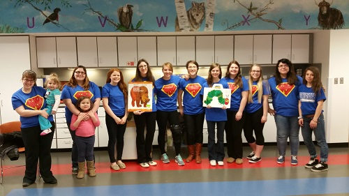 ASL club students of the 2014-2015 school year served as interpreters at the Rochester Hills Public Library's story time for children.