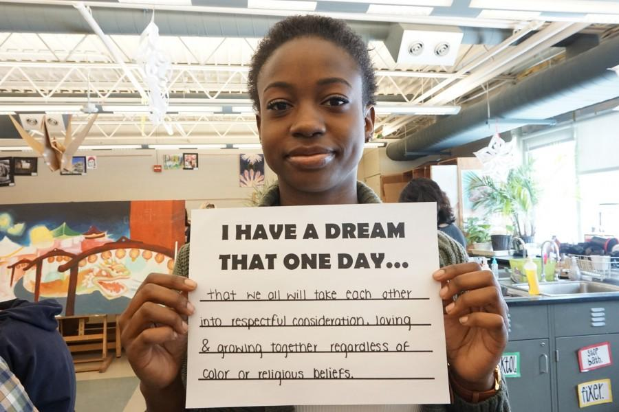 Ayanna Wyatt poses with her written dream for the continued social justice of the country and world.