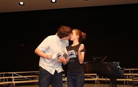 Joey Tobin and Rachel Butala kiss within a scene.