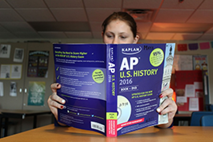 Sophomore Shelby Stimpson reads a review book in preparation for her AP US History exam.