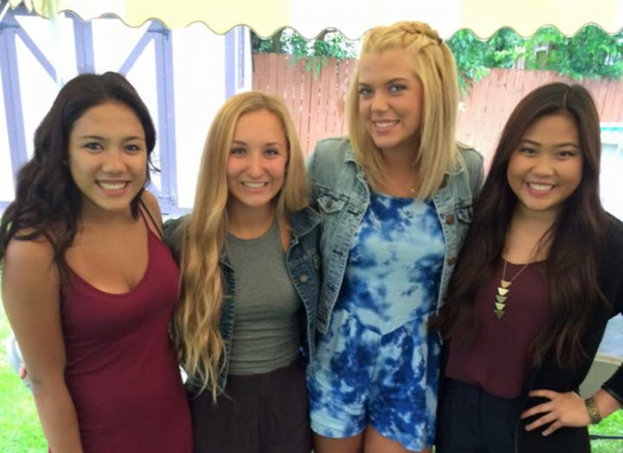 Graduate Rachel Rosario ('15), senior Gabby Leo, graduate Lexi Thompson ('15) and senior Jenny Nguyen pose at a grad party last summer.