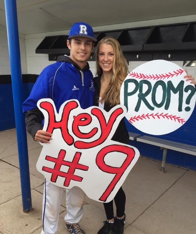 Senior%2C+Meghan+Godell+asking+junior%2C+Ryan+Gladstone+to+prom+at+his+baseball+game.+