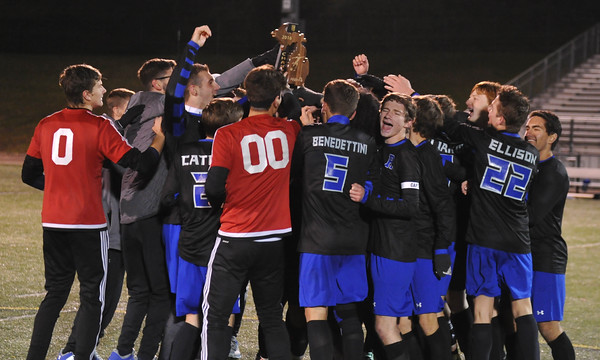 The soccer team celebrates their regional championship win after beating the Grand Blanc Bobcats. Photo Courtesy of The Oakland Press and MI Prep Zone