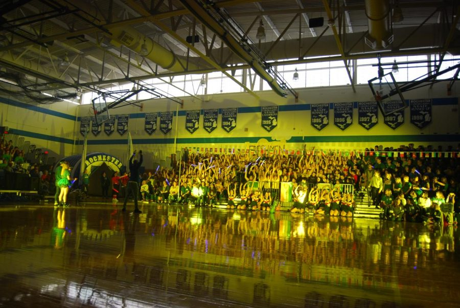 The+freshman+student+section+participate+in+%22The+Rollercoaster%22+at+their+first+homecoming+pep+assembly.+