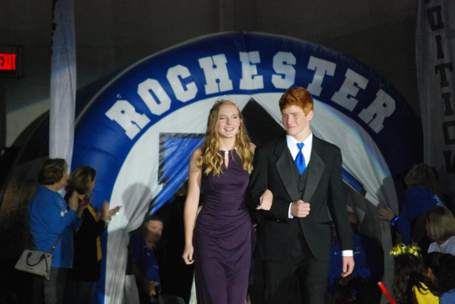 Freshman homecoming court members Lily Stellmacher and Anthony Piccirilli walk across the gym during Friday's homecoming pep assembly.