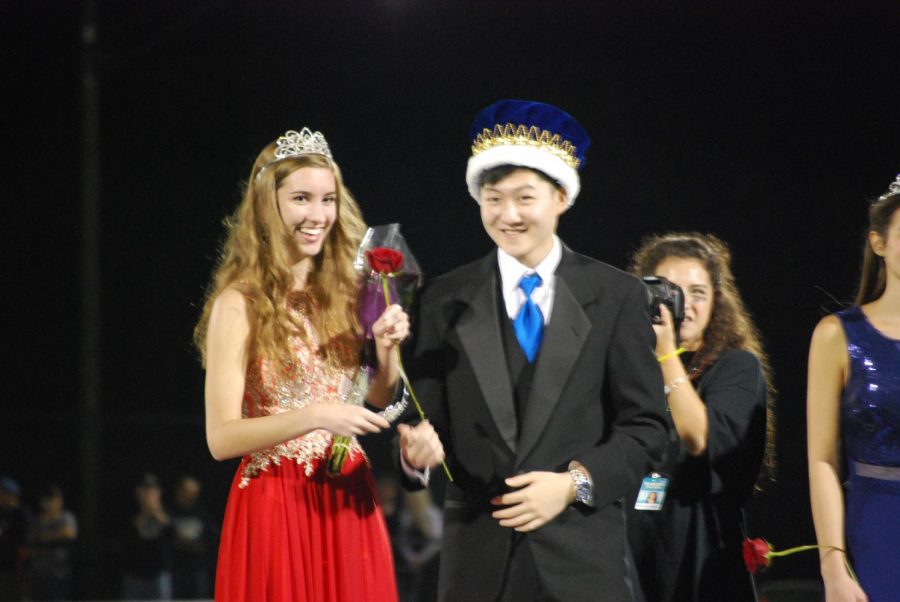 Senior homecoming court members Ellie Gnass and Dennis Kim are crowned King and Queen at the homecoming football game.