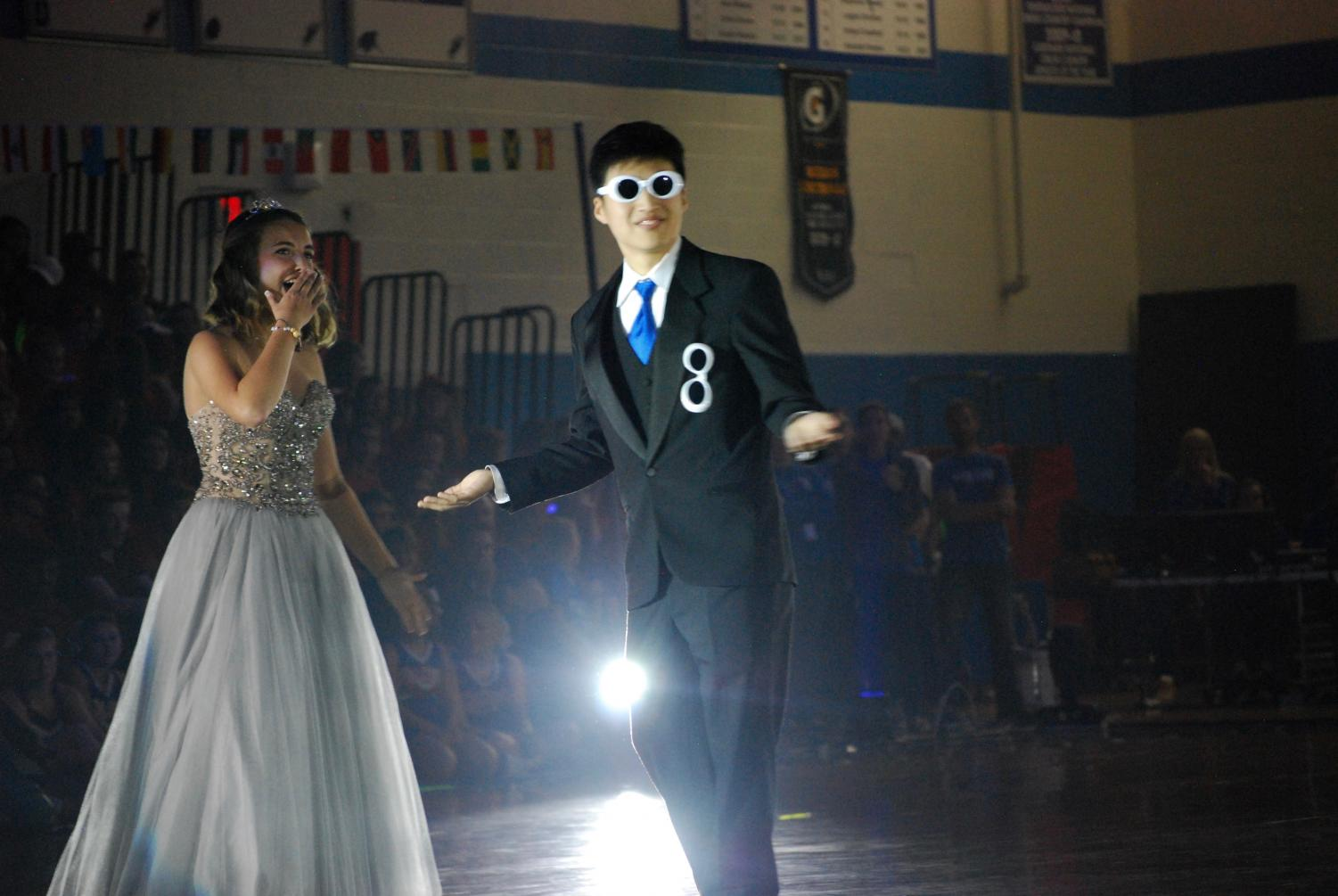 Seniors Bria Mattson and Alex Lee shock the crowd during the homecoming pep assembly.