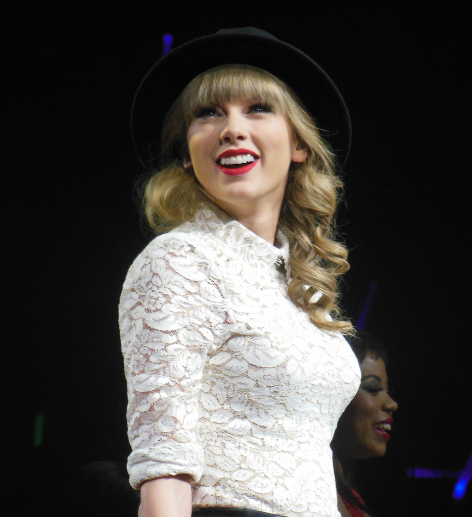 Taylor Swift smiles at her audience at a