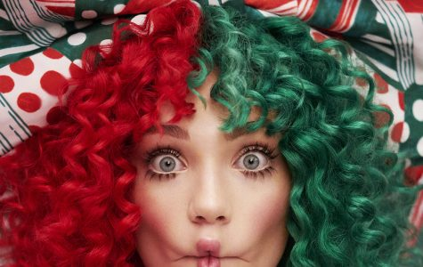 Sia dresses festively for the cover of her newest album,