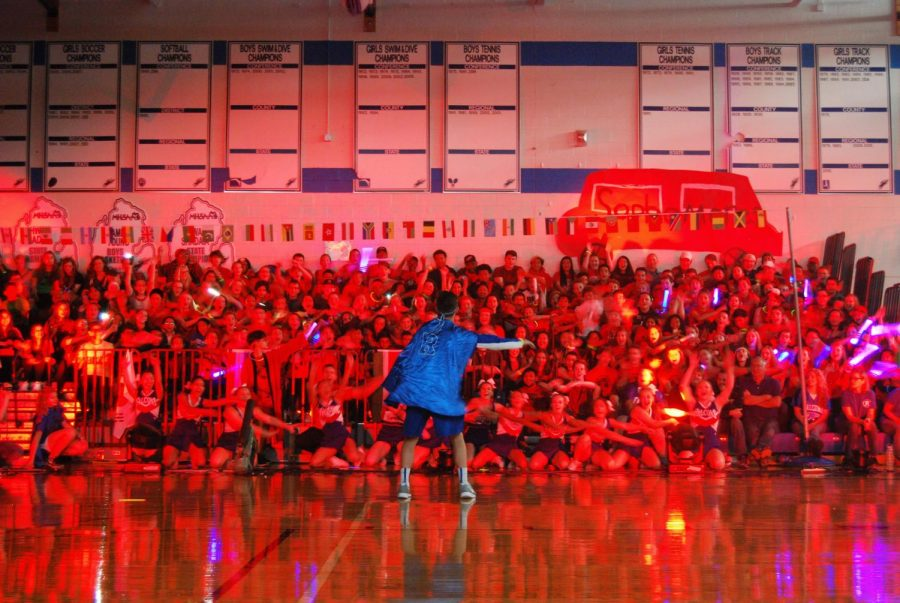 The Soldiers of Fortune lead students in the roller coaster at the homecoming pep assembly. Photo by Makenzie Shubnell.