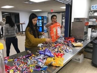 Members of the swim team separate the candy.