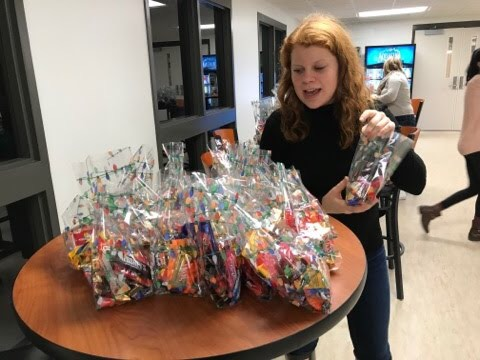 Kendall Jordan places the bagged candy together before they are tied.