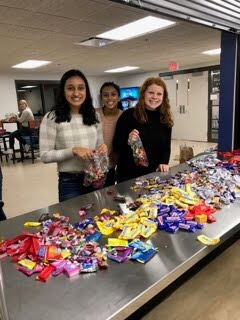 Members of the team sorting candy