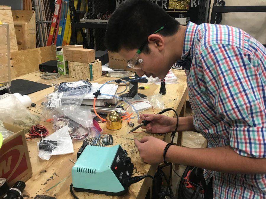 Sophomore+Nihkil+Gupta+works+on+the+robot.+