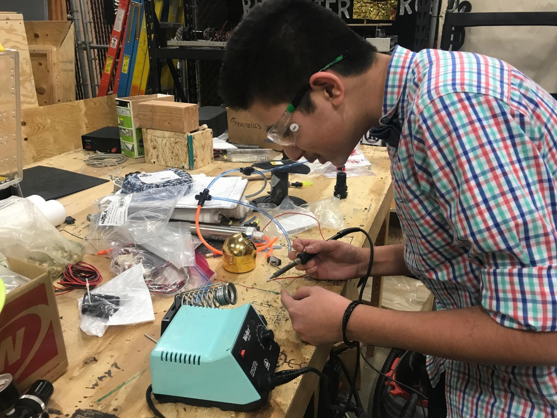 Sophomore Nihkil Gupta works on the robot.