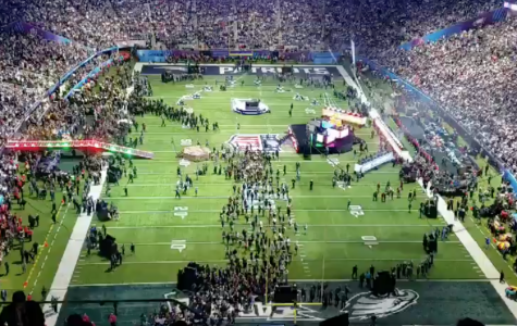 Football field gettting set up for the half-time show