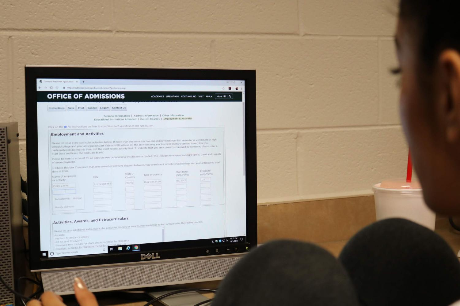 Senior Pooja Patel works on her college application. Students and parents can learn more about the application process during College Night at AHS on Oct. 16. Photo by Maggie Rhymstett