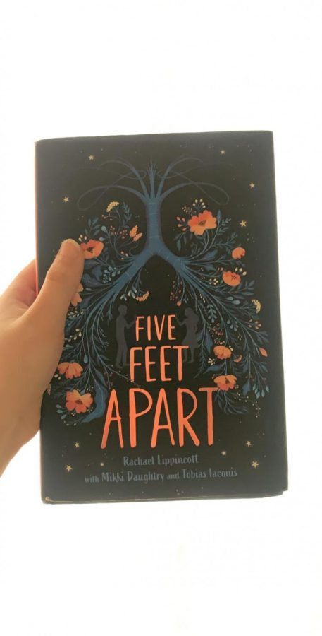 The+book+Five+Feet+Apart+is+pictured+above.+The+picture+on+the+cover+is+significant+to+the+storyline.+Photo+by+Evie+Ansari.
