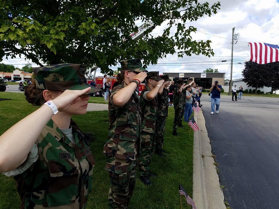 Senior Maya Smith salutes in her Young Marines Program. Photo courtesy of Maya Smith.