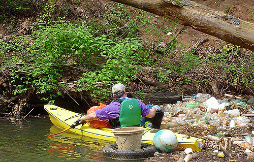 A stream being cleaned up in light of Earth Day. Photo courtesy of Creative Commons.