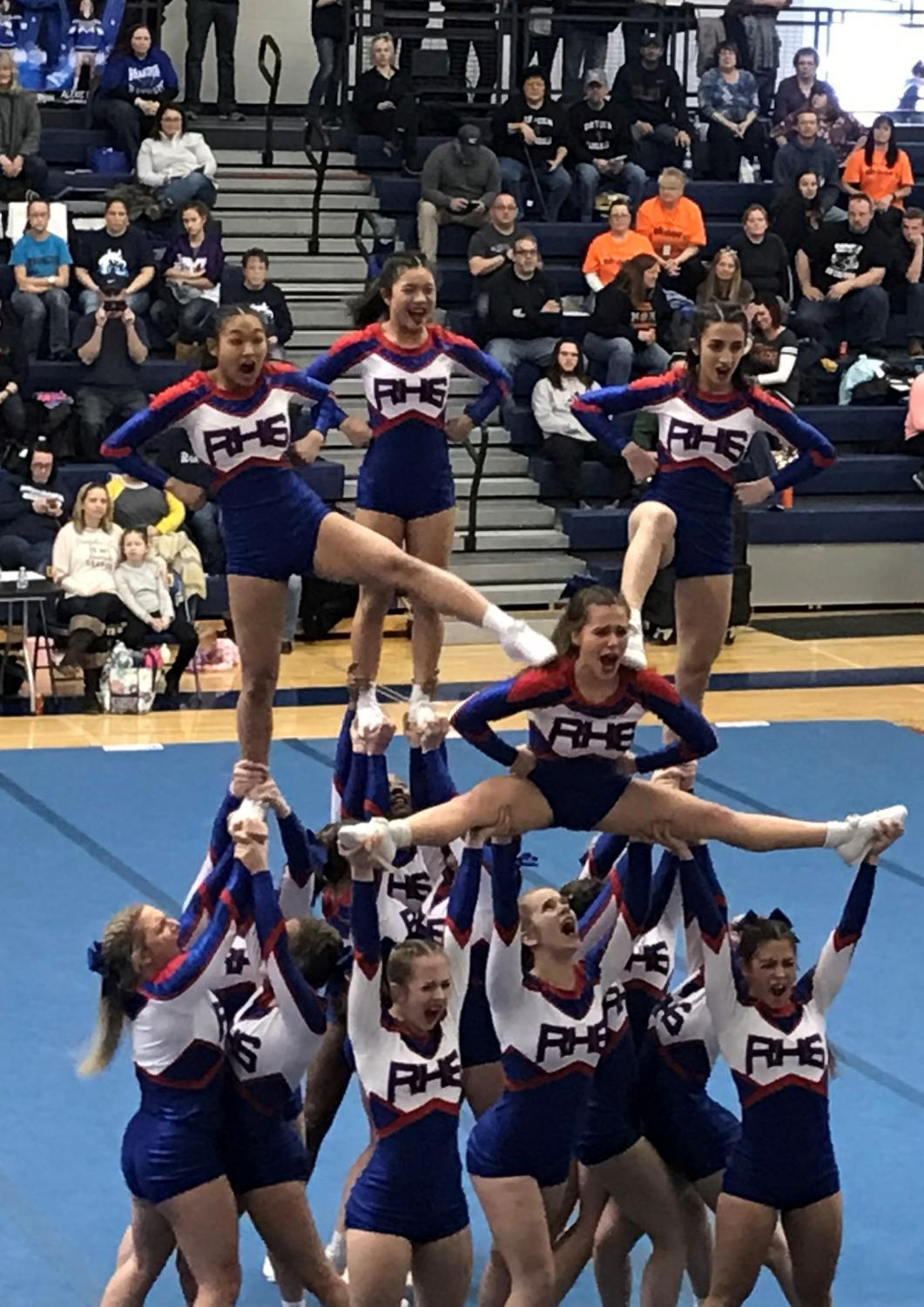 The Varsity Cheer Team at one of their last competitions. Photo  by Mariam Hanna.