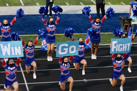The RHS Varsity Cheer Team practices social distancing and use of masks while cheering under the Friday night lights. Photo courtesy of: Janet Olivares